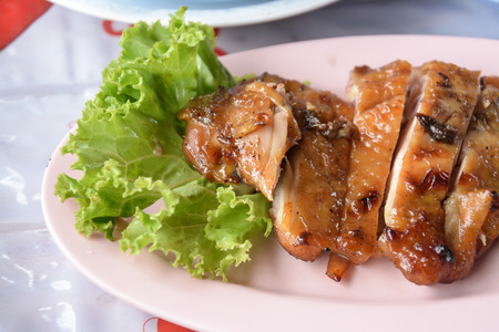 Thai style roasted chicken on disk  photo