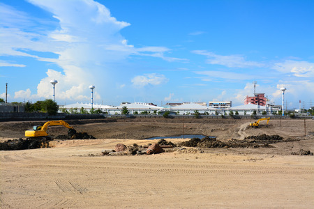 Wheel loader Excavator  loading soil at eathmoving works in construction site  photo