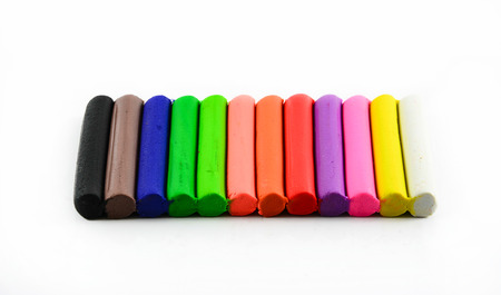Color sticks of modeling clay isolated on white  photo