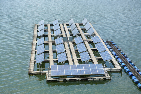 Floating Solar Energy Panels on a lake photo