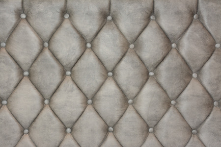 Luxurious silver leather texture furniture with buttons photo