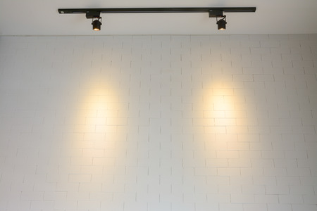 white brick wall with track light photo