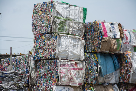 plastic and can waste on a recycling site