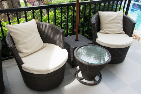 black Rattan armchairs