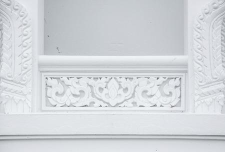 White stucco , thai style on the Wall photo