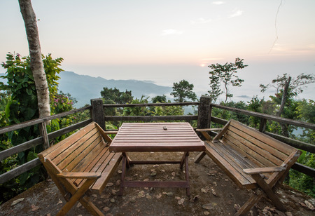 wood chair and table on balcony inthe morning at Doi  Tung, Chiang Rai photo