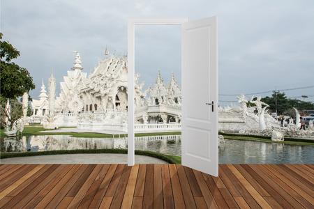 Landscape behind the opening door photo