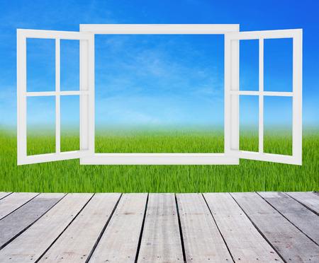 opening window: paisaje detr�s de la ventana de apertura Foto de archivo