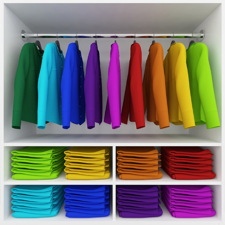 laundry hanger: Colorful clothes hanging and stack of clothing  in wardrobe Stock Photo