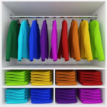 ropa colgada: Ropa de colores colgando y la pila de ropa en el armario Foto de archivo