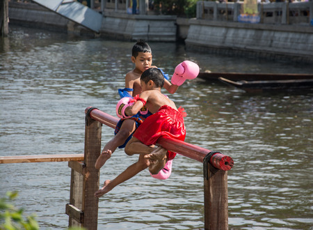 BANGKOK, THAILAND - FEB. 14 :traditional water Thai boxing (or Muay Talay) - ancient Thai fight above the water - at Bangkok floating market, Thailand on February 14, 2015.