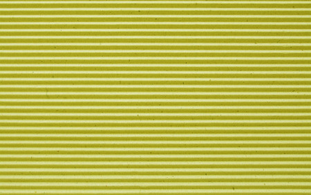 goffer: yellow  corrugated paper background. Stock Photo