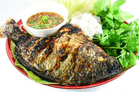 Tilapia grilled with vegetable isolate on white Stock Photo