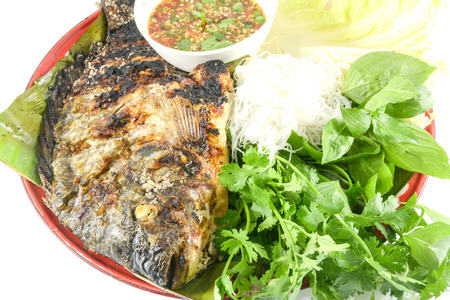 broil: Tilapia grilled with vegetable isolate on white Stock Photo