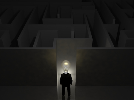 Businessman with bulb in front of a mysterious maze photo