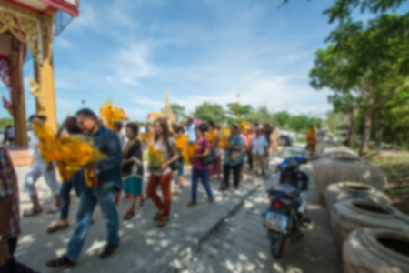 ordination: defocused of Thai new monk parade in the newly buddhist ordination ceremony