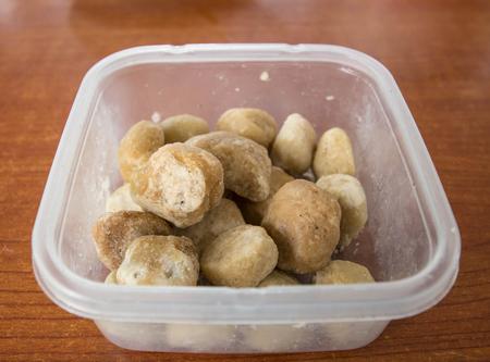 regional: Burma cuisine, coconut with brown sugar coating regional snack food Stock Photo