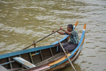 boatman: U Bein Bridge, Myanmar-Aug 02th, 2015: Burmese boatman at U Bein bridge, Taung