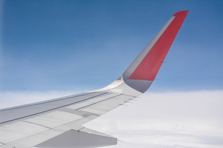 airplane window: wing of the plane