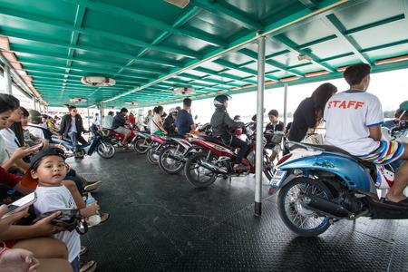 samutprakarn: SAMUTPRAKARN - AUGUST 29:passengers with motercycle on passenger liner in Chao Phraya river on August 29, 2015  in Samutprakarn, Thailand. Editorial