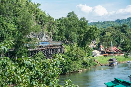 infra construction: rains running on death railways track crossing kwai river in kanchanaburi