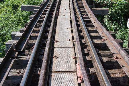 infra construction: trains running on death railways track crossing kwai river in kanchanaburi