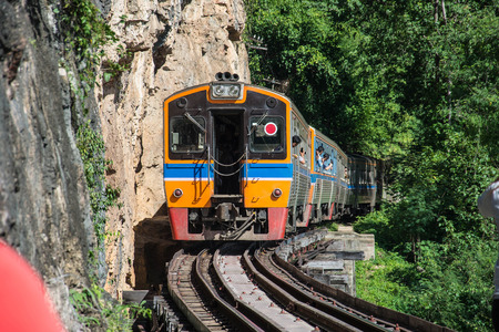 infra construction: trains running on death railways track crossing kwai river in kanchanaburi thailand this railways important destination of world war II history builted by soldier prisoners Editorial