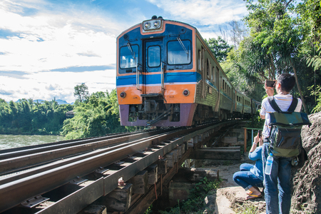 infra construction: rains running on death railways track crossing kwai river in kanchanaburi thailand this railways important destination of world war II history builted by soldier prisoners