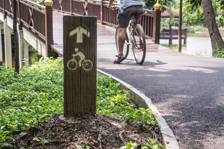 single lane road: bicycle lane sign in park Stock Photo