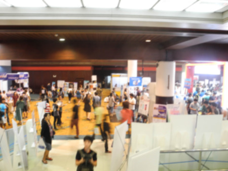 business exhibition: Abstract people walking in exhibition blurred background