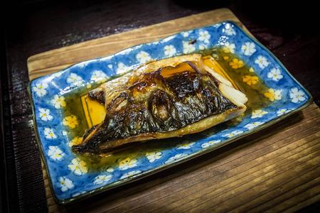 flesh eating animal: grilled fish, saba shioyaki Stock Photo