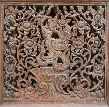 latticework: Carved wooden latticework with pattern of flowers and Garuda
