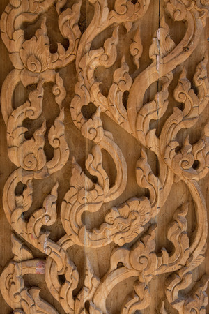 Carved wooden latticework with pattern of thai stlye Stock Photo