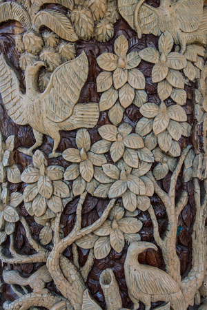 latticework: Carved wooden latticework pattern of tree with bird