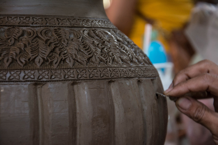 earthenware: Carving clay for make earthenware.