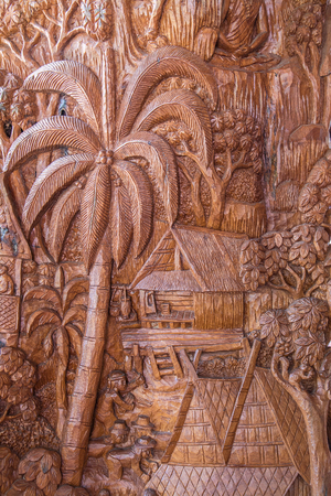 latticework: Carved wooden latticework pattern of tree with house,Thai tradition