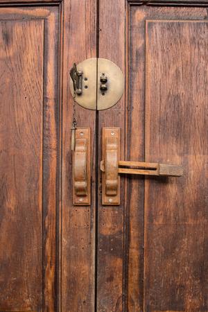 door handle: Vintage door handle on wooden door