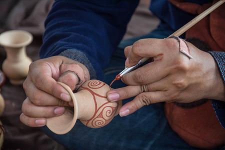 thani: Man painting on vase ,Ban Chiang, Udon Thani Thailand
