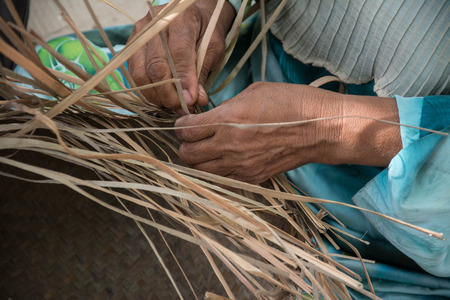 basket weaving: Weaving a wicker basket by handmade Stock Photo