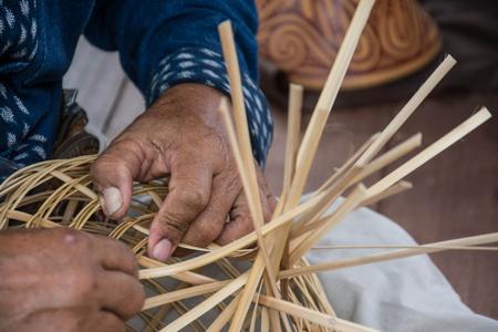 basket weaving: Weaving a bamboo basket by handmade