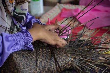 basket weaving: Weaving a wicker basket by handmade Stock Photo