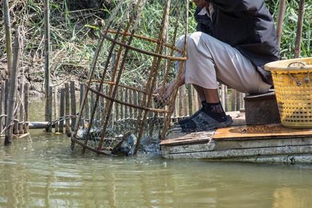trap: fisherman use fish trap,Thailand