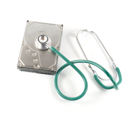 ata: hard disk with a sthetoscope isolated on white background