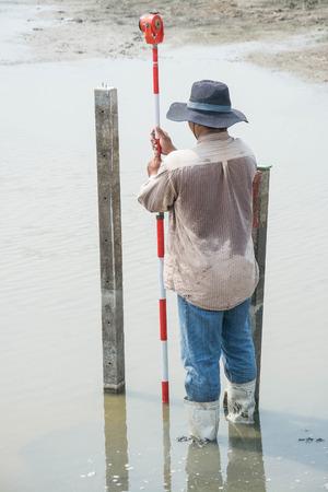 exact position: man survey boundary of area