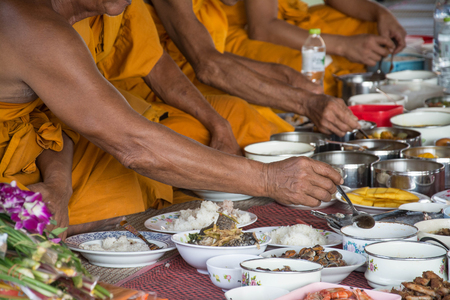 temple thailand: food and drink for monks in traditional religious ceremony in a temple , Thailand. Stock Photo