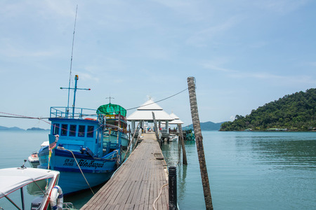 excursions: KOH CHANG, THAILAND - MAY 07, 2016: Tourist boat at the pier in Bang Bao fishing village . From the pier of Bang Bao daily boats for excursions.