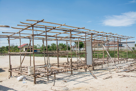 temporary: wood construction of labor temporary houses in construction  site. Stock Photo
