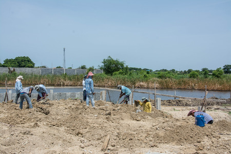 samutprakarn: Samutprakarn, Thailand July 12,2016: worker  digging hole with a hoe  at construction site