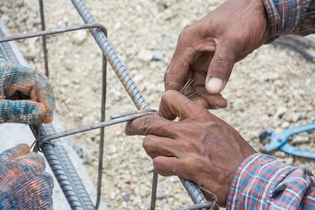 berm: construction workers steel tie