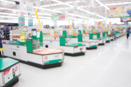 blur image of supermarket store ,Cashier counter with customer